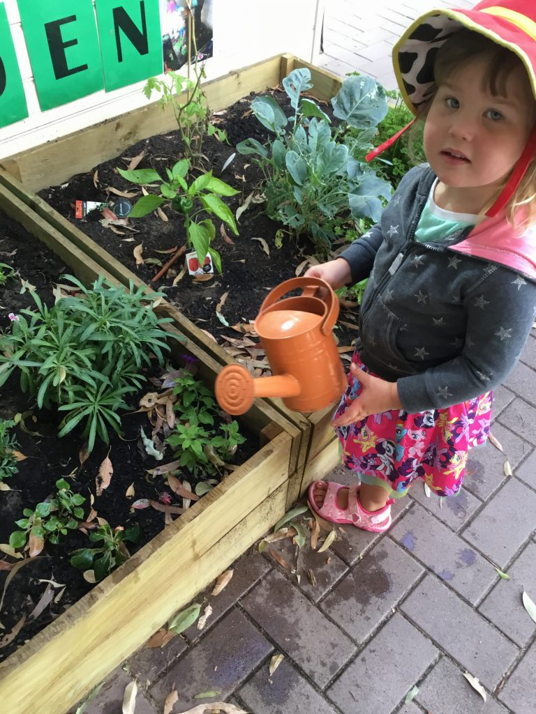 Our children love to water the flowers at our childcare centre.